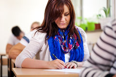 Student girl writing at school Stock Photography