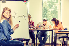 Student girl writting Learning word on whiteboard Royalty Free Stock Photos