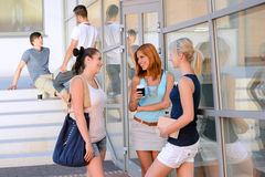 Student girls chatting together outside college Royalty Free Stock Photos