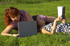 Student girls on the grass Stock Photos