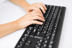 Student girls hands typing on keyboard Royalty Free Stock Image