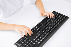 Student girls hands typing on keyboard Stock Photo