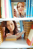 Student girls in library Royalty Free Stock Photography
