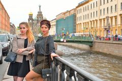 Student girls standing at the gate of the Griboyedov Canal emban Royalty Free Stock Photos