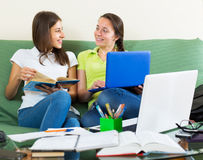 Student girls studying at home Royalty Free Stock Photo