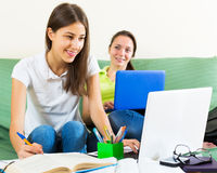 Student girls studying at home Stock Photo