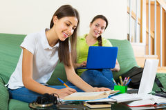 Student girls studying at home Royalty Free Stock Photos