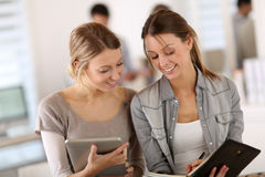 Student girls taking notes in agenda Stock Image