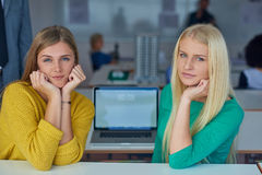 Student girls together in classroom Royalty Free Stock Photo