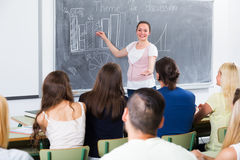 Student gives answer near blackboard Royalty Free Stock Images