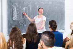 Student gives answer near blackboard Royalty Free Stock Photo