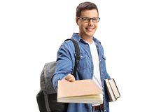 Student giving a book and smiling Royalty Free Stock Images