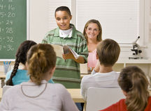 Student giving report in classroom Stock Photo
