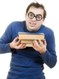 Student in glasses with a book on her head. Funny student in glasses carefully pressed to his breast a book on white background stock photos