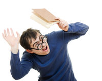 Student in glasses with a book over his head Stock Photography