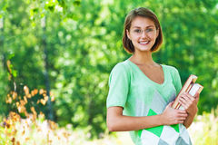 Student with glasses and books Royalty Free Stock Photos
