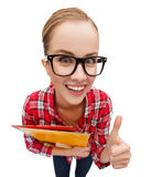 Student in glasses with folders showing thumbs up Royalty Free Stock Images