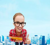Student in glasses with folders showing thumbs up Stock Photography