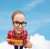 Student in glasses with folders showing thumbs up Royalty Free Stock Image