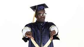 Student in glasses showing thumbs down. White. Close up. Student in glasses showing thumbs down, black male unhappy and shows emotions on the face, on a white stock video