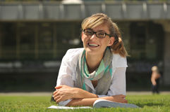 Student with glasses smiling Royalty Free Stock Image