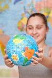 Student with globe Stock Photo