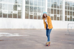 Student going on skateboard. Student going on a skateboard in the autumn royalty free stock image