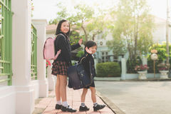 Student going to school and waving goodbye Stock Photos