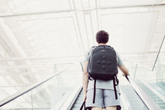 Student going up escalator Royalty Free Stock Image