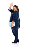 Student goodbye. Full length of cheerful overweight student waving goodbye isolated on white background stock photography
