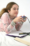 Student Goofing Off 1. A student playing video games instead of doing her math homework Royalty Free Stock Image