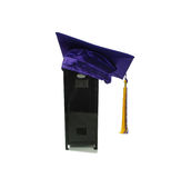 Student graduate. Graduation mortar board with tassle used during ceremonies, Black metal locker used to store items while participating in extra curricular Royalty Free Stock Images