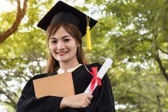 Student graduate holding certificated in hand royalty free stock photos