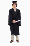 Student in graduate robe. Against a white background Stock Images