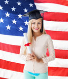 Student in graduation cap with certificate Stock Photography