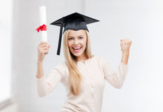 Student in graduation cap with certificate Royalty Free Stock Image