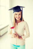 Student in graduation cap with certificate Royalty Free Stock Images