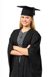Student In Graduation Gown With Arms Crossed Stock Photo