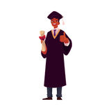 Student in graduation gown and cap with diploma, thumb up Stock Image