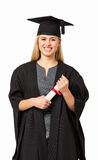 Student In Graduation Gown Holding Certificate Royalty Free Stock Images
