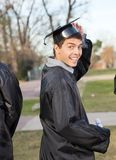 Student In Graduation Gown Holding Certificate On Royalty Free Stock Image