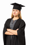 Student In Graduation Gown med korsade armar Royaltyfri Bild