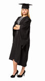 Student In Graduation Gown Standing Arms Crossed Royalty Free Stock Image