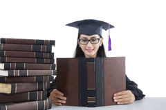 Student with graduation gown studying Royalty Free Stock Photography