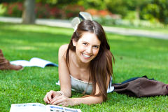 Student on the grass Stock Photos
