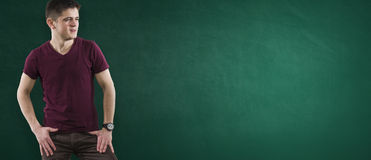 Student on green chalkboard Stock Photography