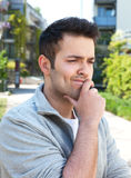Student in a grey jacket with problems Royalty Free Stock Photo