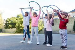 Student group is doing exercise with hoops royalty free stock image