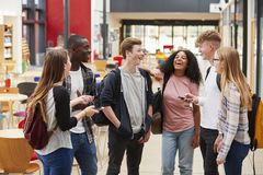 Student Group Socializing In Communal Area Of Busy College royalty free stock photography