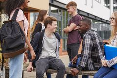 Student Group Socializing Outside College Buildings stock photos